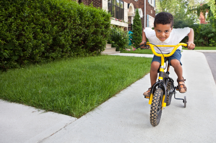Young Boy Riding a bicycle XSmall